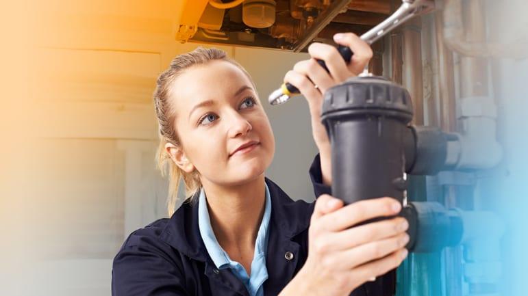 Woman Working on Plumbing