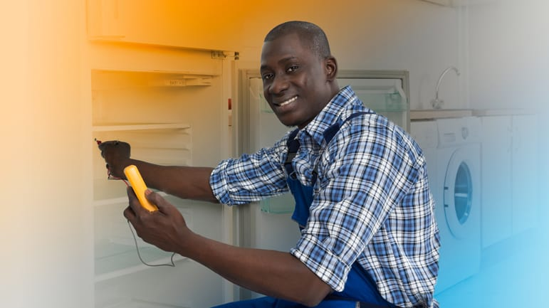 Man Working on Refrigerator